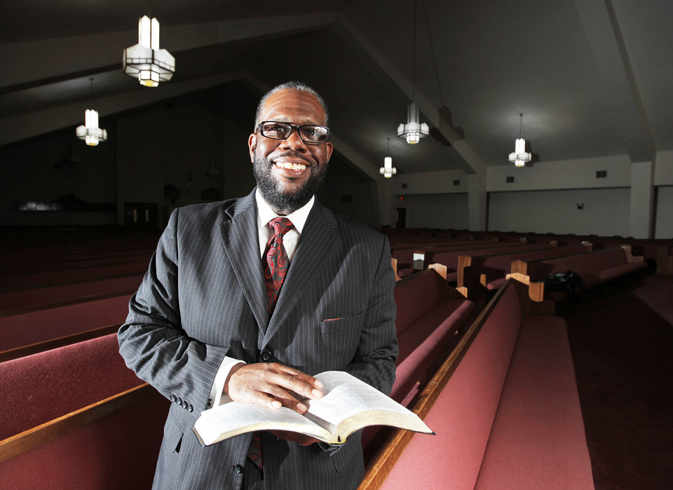 The Rev. Ray Douglas poses for a picture in the sanctuary of Greater Mount Olive Baptist Church, 1020 NE 42, where he is senior pastor.  Photo by Garett Fisbeck, The Oklahoman