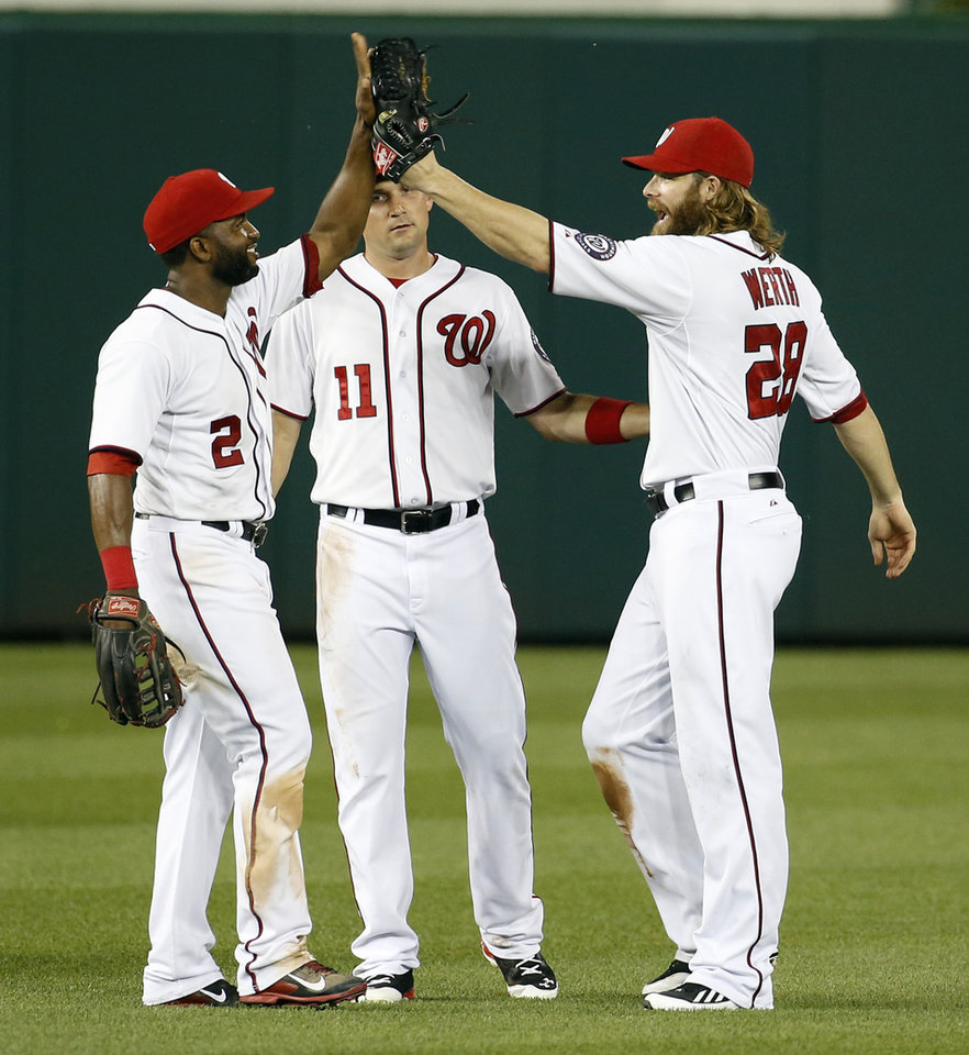 Photo - Washington Nationals outfielders Denard Span, left, Ryan Zimmerman and Jayson Werth celebrate after an interleague baseball game against the Houston Astros at Nationals Park Wednesday, June 18, 2014, in Washington. The Nationals won 6-5. (AP Photo/Alex Brandon)