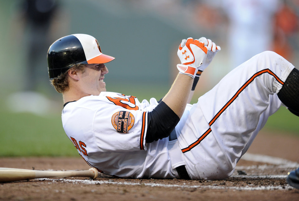 Photo -   Baltimore Orioles' Mark Reynolds reacts after being hit by a pitch during the second inning of a baseball game against the Los Angeles Angels, Wednesday, June 27, 2012, in Baltimore. Reynolds stayed in the game. The Angels won 13-1. (AP Photo/Nick Wass)