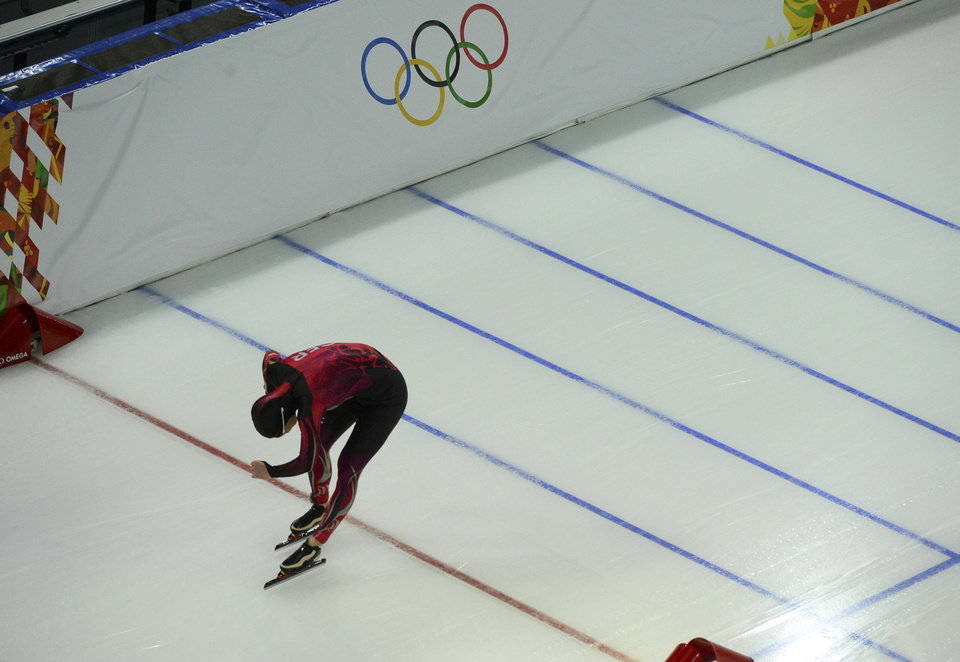 Photo - Fifth placed Claudia Pechstein of Germany crosses the finish line in the women's 5,000-meter speedskating race at the Adler Arena Skating Center during the 2014 Winter Olympics in Sochi, Russia, Wednesday, Feb. 19, 2014. (AP Photo/Antonin Thuillier, Pool)