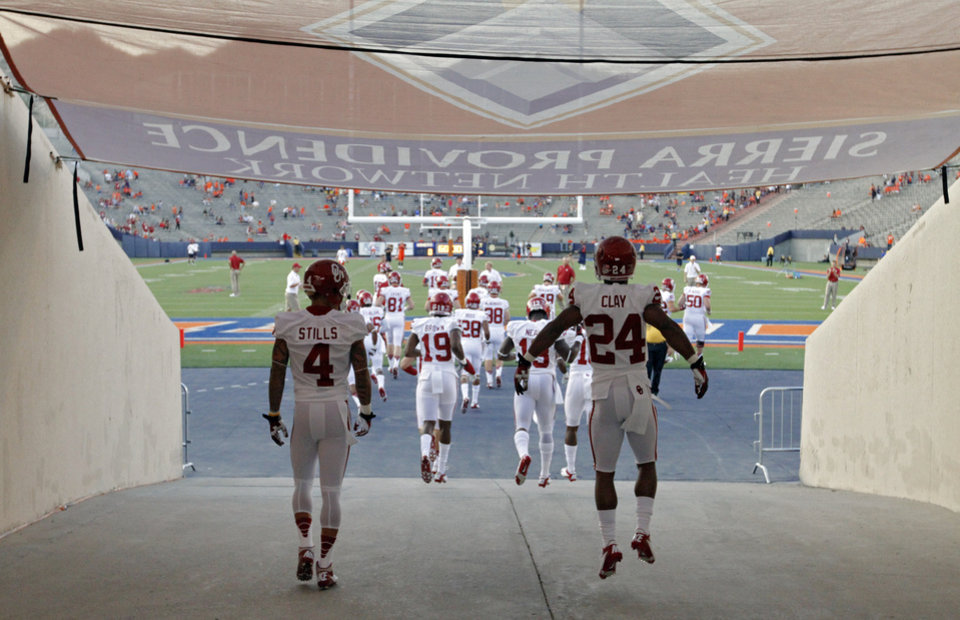 Photo - Sooners take to the field for pre-game during the college football game between the University of Oklahoma Sooners (OU) and the University of Texas El Paso Miners (UTEP) at Sun Bowl Stadium on Saturday, Sept. 1, 2012, in El Paso, Tex.  Photo by Chris Landsberger, The Oklahoman