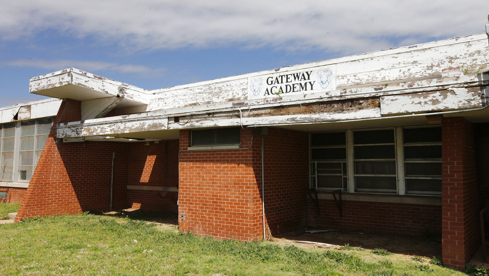Photo - The former Gatewood Academy school building, with peeling paint and rotting wood, is shown Monday at 721 W Britton Road in Oklahoma City.  Photo by Paul B. Southerland, The Oklahoman