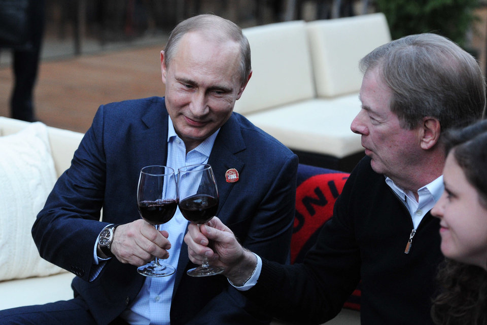 Photo - Russian President Vladimir Putin, left, toasts member of the International Olympic Committee Larry Probst while visiting USA House during the 2014 Winter Olympics, Friday, Feb. 14, 2014 in Sochi, Russia.  (AP Photo/RIA-Novosti, Mikhail Klimentyev, Presidential Press Service)