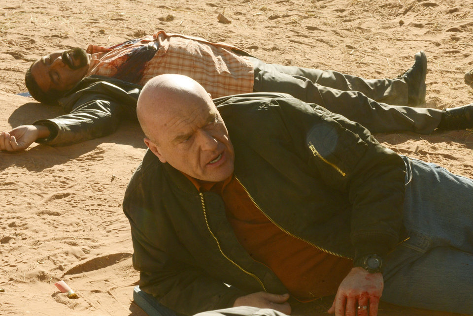 "This image released by AMC shows Hank Schrader, played by Dean Norris, foreground, and Steven Gomez, played by Steven Michael Quezada, in episode from season five of  ""Breaking Bad."" The series finale of the popular drama series airs on Sunday, Sept. 29. (AP Photo/AMC, Ursula Coyote)"