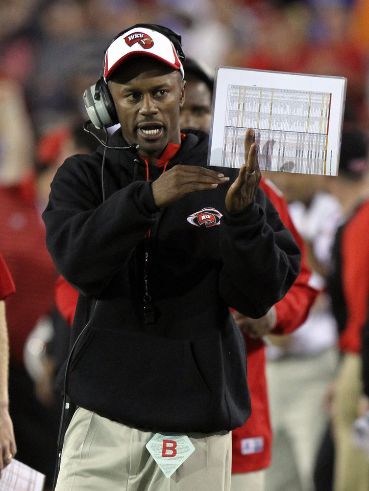 Photo -   Western Kentucky head coach Willie Taggart calls a time out during overtime of an NCAA college football game against Kentucky at Commonwealth Stadium in Lexington, Ky., Saturday, Sept. 15, 2012. Western Kentucky won 32-31. (AP Photo/James Crisp)