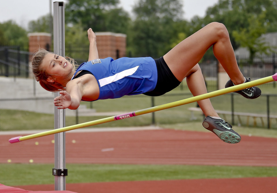 Photo - Deer Creek's Jessica Holley competes in the Class 5A girls high jump during the Class 6A and 5A state championship track meet at Yukon High School on Saturday, May 17, 2014 in Yukon, Okla.   Photo by Chris Landsberger, The Oklahoman