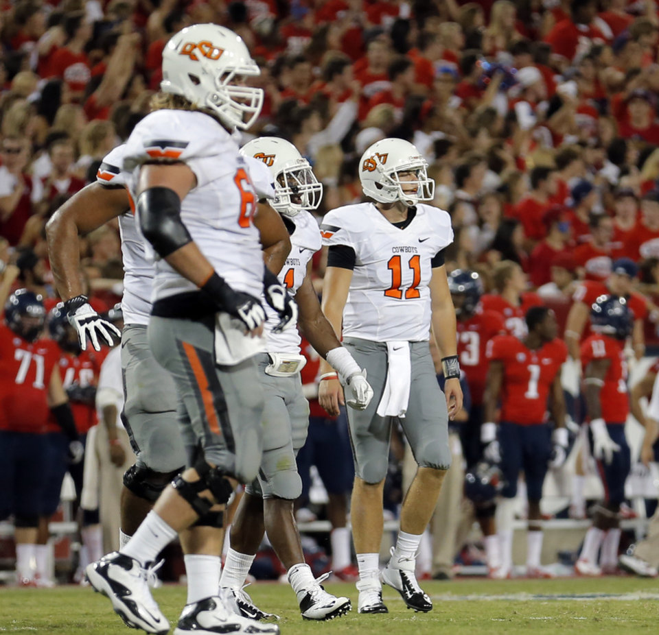 Photo - Oklahoma State's Wes Lunt (11) reacts to an interception during the college football game between the University  of Arizona and Oklahoma State University at Arizona Stadium in Tucson, Ariz.,  Sunday, Sept. 9, 2012. Photo by Sarah Phipps, The Oklahoman