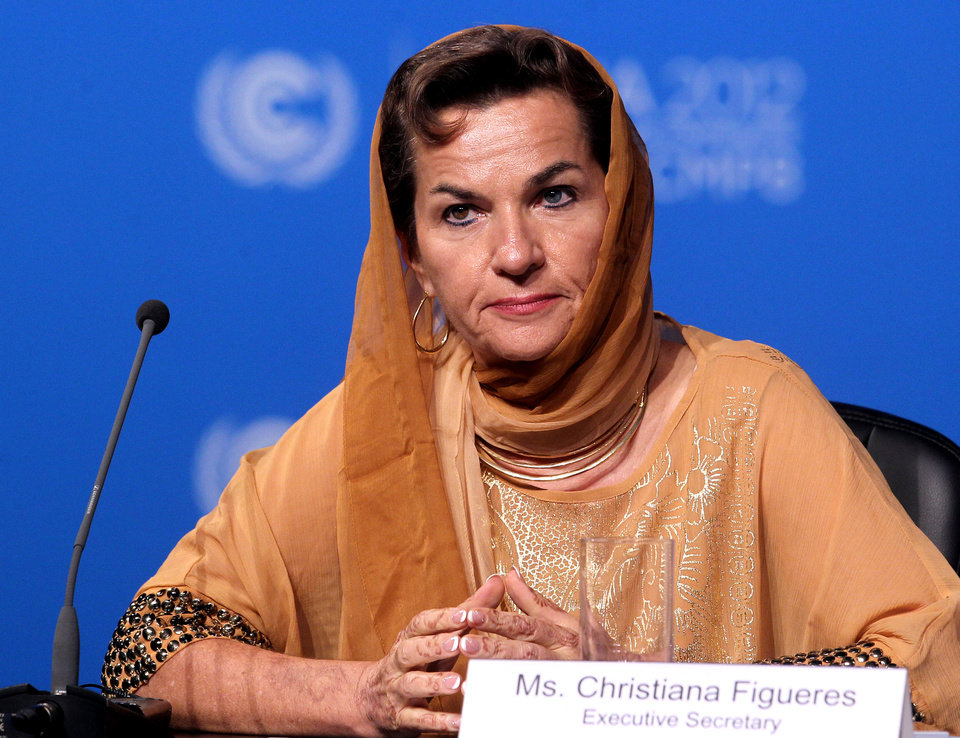 Photo - Christiana Figueres, Executive Secretary of the United Nations Framework Convention on Climate Change (UNFCCC)  attends the opening session of the United Nations Climate Change conference in Doha, Qatar, Monday, Nov. 26, 2012. U.N. talks on a new climate pact resumed Monday in oil and gas-rich Qatar, where negotiators from nearly 200 countries will discuss fighting global warming and helping poor nations adapt to it. The two-decade-old talks have not fulfilled their main purpose: reducing the greenhouse gas emissions that scientists say are warming the planet. (AP Photo/Osama Faisal)