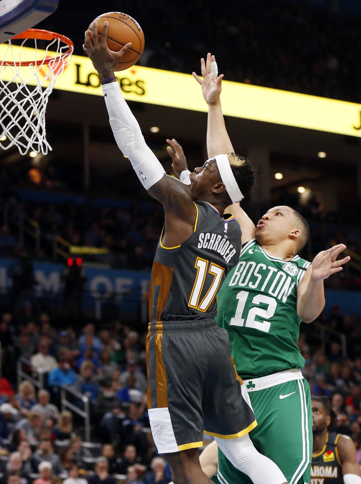 Photo - Oklahoma City's Dennis Schroder (17) takes the ball to the rim past Boston's Grant Williams (12) in the third quarter during an NBA basketball game between the Oklahoma City Thunder and the Boston Celtics at Chesapeake Energy Arena in Oklahoma City, Sunday, Feb. 9, 2020. Boston won 112-111. [Nate Billings/The Oklahoman]