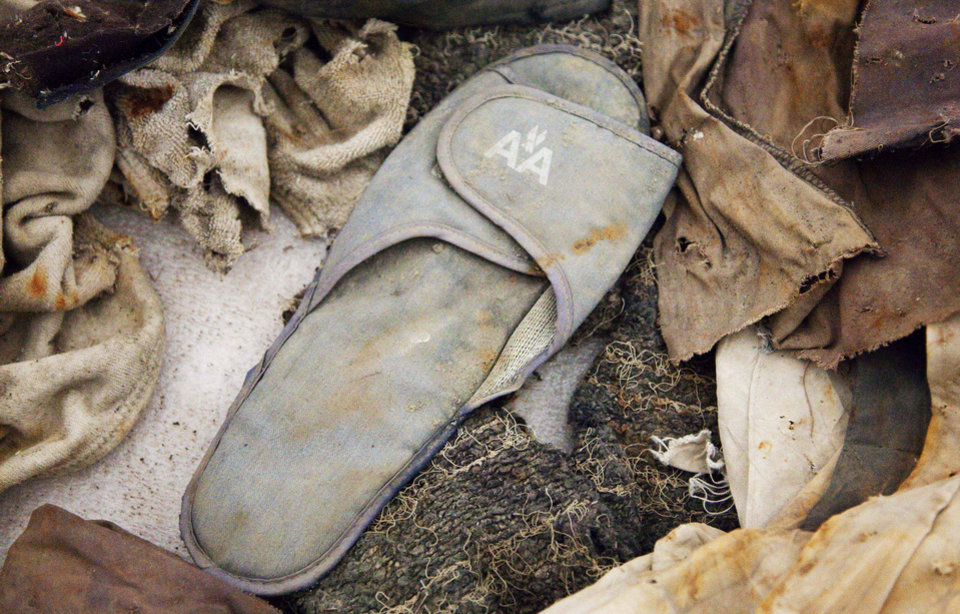 Photo - FILE - This file photo of June 19, 2011 shows an American Airlines slipper stored in Hangar 17 at John F. Kennedy International Airport in New York. The slipper is an artifact from the Sept. 11, 2001 attacks that is to be part of the National September 11 Memorial Museum, which will be dedicated Thursday, May 15, 2014, in a ceremony attended by President Barack Obama. It will open to the public May 21. (AP Photo/Mark Lennihan, File)