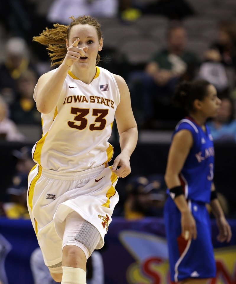 Photo - Iowa State' Chelsea Poppens (33) points toward a teammate after scoring against Kansas in the second half of an NCAA college basketball game in the Big 12 women's tournament Saturday, March 9, 2013, in Dallas. Poppens had 24-points in the 77-62 win over Kansas. (AP Photo/Tony Gutierrez)