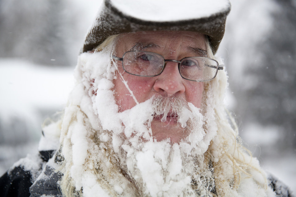 Photo - Lee Tuttle, 66, takes a break from blowing snow off of his driveway to pose for a portrait on Sunday, January 5, 2014 at his home on Miller Road in Flint, Mich. He said he hadn't really noticed the icicles forming in his beard.     (AP Photo/The Flint Journal, :Michelle Tessier) LOCAL TV OUT; LOCAL INTERNET OUT