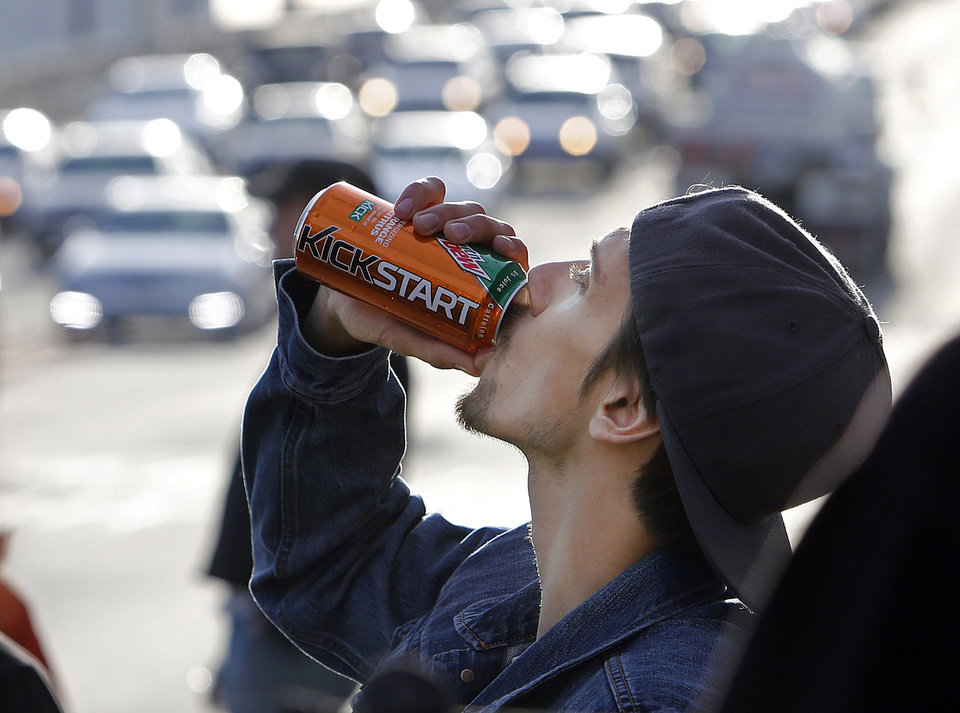 Photo - Actor Norbert Torok rehearses as the crew watches during the filming of a commercial for a new PepsiCo product called Kickstart, a carbonated drink that is part juice with Mountain Dew flavor, on the streets of downtown Los Angeles Tuesday, Jan. 29, 2013.   PepsiCo Inc. is set to roll out the new drink called Kickstart this month that has Mountain Dew flavor but is made with 5 percent juice and an extra jolt of caffeine and Vitamins B and C. The company is hoping to grow sales by reaching Mountain Dew fans at a new time of day: morning.  (AP Photo/Reed Saxon)