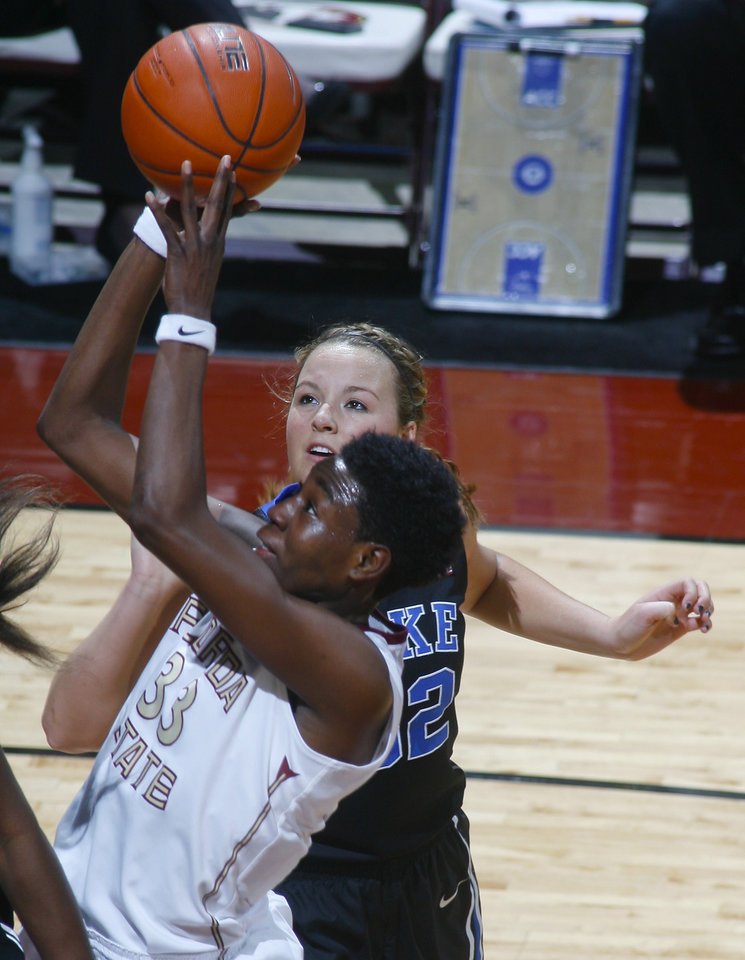 Photo - Florida State forward Natasha Howard (33) makes a short jumper as she is fouled by Duke guard Tricia Liston (32) in the first half of an NCAA women's college basketball game, Thursday, Jan. 23, 2014, in Tallahassee, Fla. (AP Photo/Phil Sears)