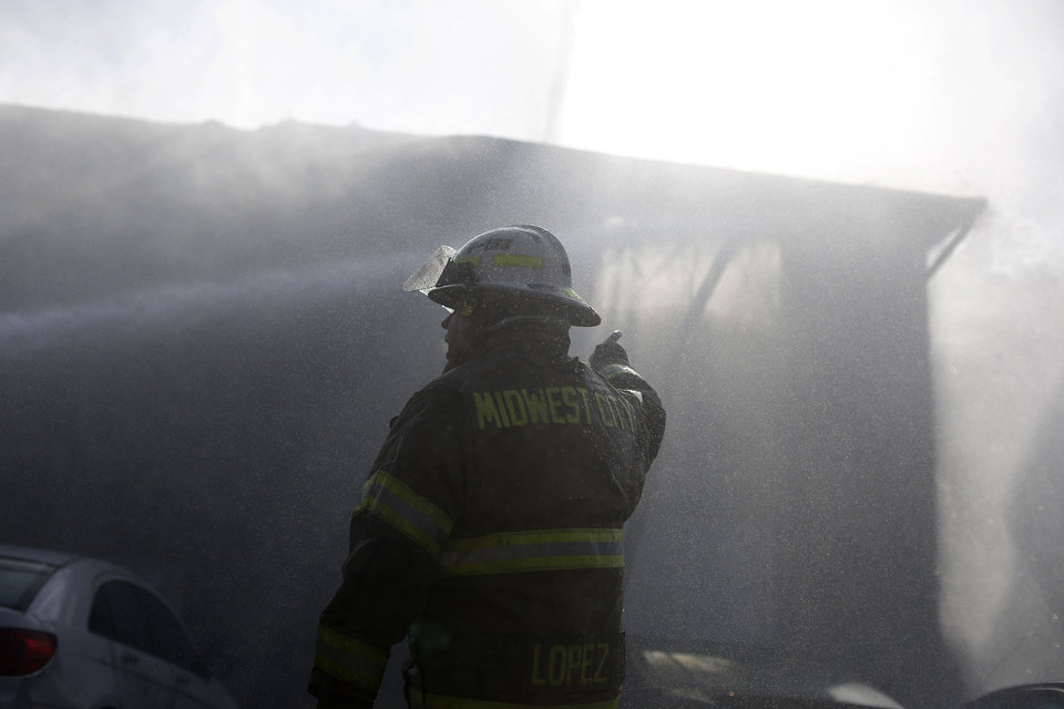 Firefighters were called Wednesday to a blaze at the Eden Cove Apartments in Midwest City. Photo by Garett Fisbeck, For The Oklahoman <strong>Garett Fisbeck</strong>