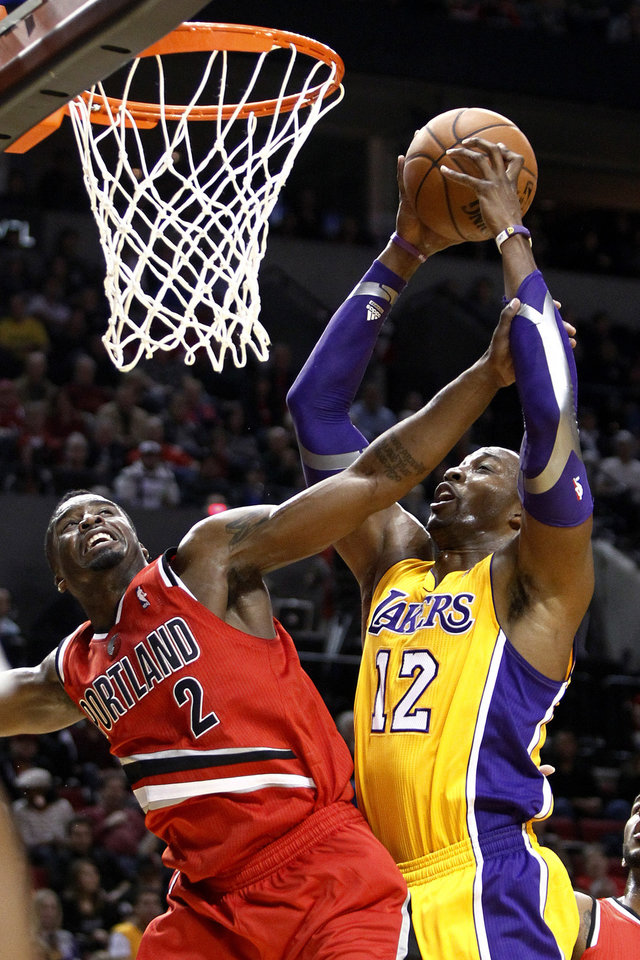 Photo -   Los Angles Lakers center Dwight Howard, right, is fouled while shooting by Portland Trail Blazers guard Wesley Matthews during the first quarter of an NBA basketball game in Portland, Ore., Wednesday, Oct. 31, 2012. (AP Photo/Don Ryan)
