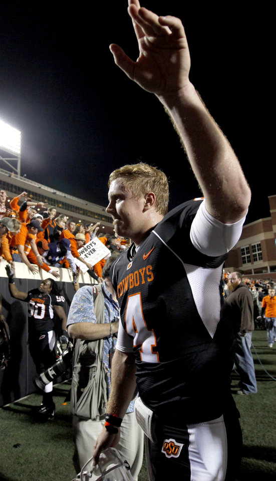 OSU's Brandon Weeden waves to fans after  the college football game between Oklahoma State University (OSU) and the University of Colorado (CU) at Boone Pickens Stadium in Stillwater, Okla., Thursday, Nov. 19, 2009. Photo by Bryan Terry, The Oklahoman