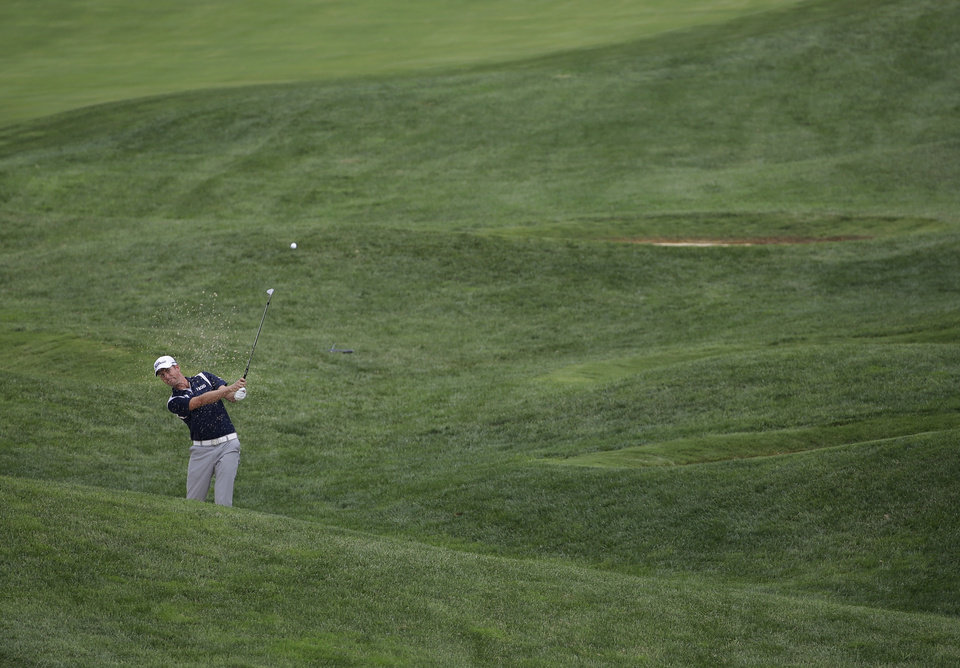 Photo - Webb Simpson hits from rough on the 13th hole during a practice round for the PGA Championship golf tournament at Valhalla Golf Club on Tuesday, Aug. 5, 2014, in Louisville, Ky. The tournament is set to begin on Thursday. (AP Photo/David J. Phillip)