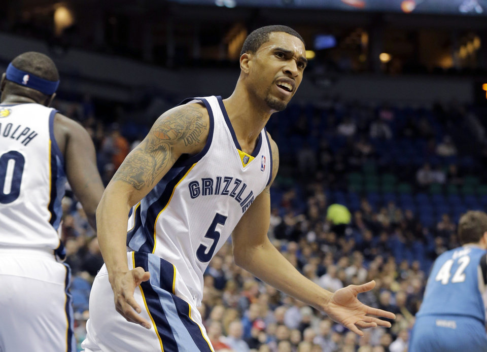 Photo - Memphis Grizzlies guard Courtney Lee (5) disagrees with a call during the first quarter of an NBA basketball game against the Minnesota Timberwolves in Minneapolis, Wednesday, April 2, 2014. The Timberwolves won 102-88. (AP Photo/Ann Heisenfelt)