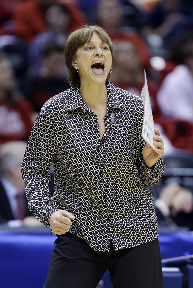 Photo - Nebraska head coach Connie Yori yells to her team as they played Iowa in the first half of an NCAA college basketball game in the finals of the Big Ten women's tournament in Indianapolis, Sunday, March 9, 2014. (AP Photo/Michael Conroy)
