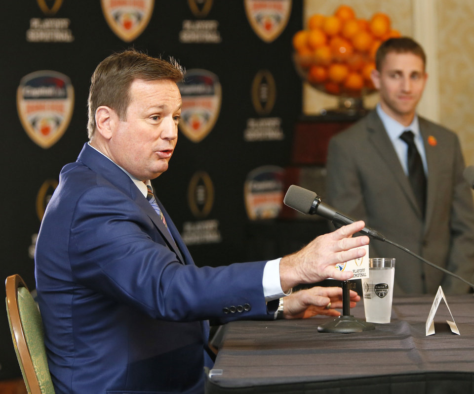 Photo - OU coach Bob Stoops speaks during a news conference for the Capital One Orange Bowl, a College Football Playoff Semifinal game, at the Renaissance Fort Lauderdale Cruise Port Hotel in Fort Lauderdale, Florida, Wednesday, Dec. 30, 2015. The Oklahoma Sooners will play the Clemson Tigers on News Year's Eve. Photo by Nate Billings, The Oklahoman