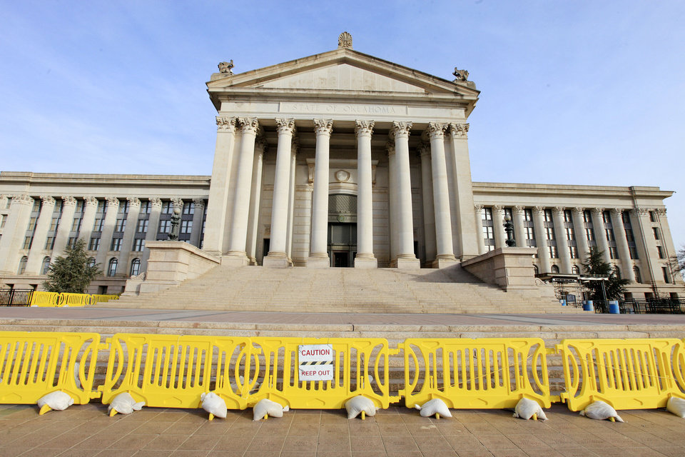Photo - Oklahoma lawmakers will once again be greeted by ugly yellow barricades Monday when they return to the state Capitol for the start of the 2014 legislative session. Photo by Paul B. Southerland, The Oklahoman  PAUL B. SOUTHERLAND - PAUL B. SOUTHERLAND