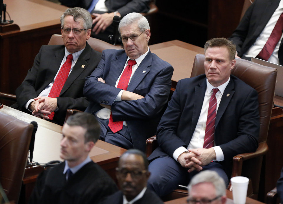 Photo - Rep. Pat Ownbey, R-Ardmore, state Sen. Frank Simpson, R-Ardmore and state Rep. Todd Thomsen, R-Ada listen as Oklahoma Governor Mary Fallin gives her final State of the State Address in the chambers of the Oklahoma House of Representatives on Monday, Feb. 5, 2018 in Oklahoma City, Okla.  Photo by Steve Sisney, The Oklahoman