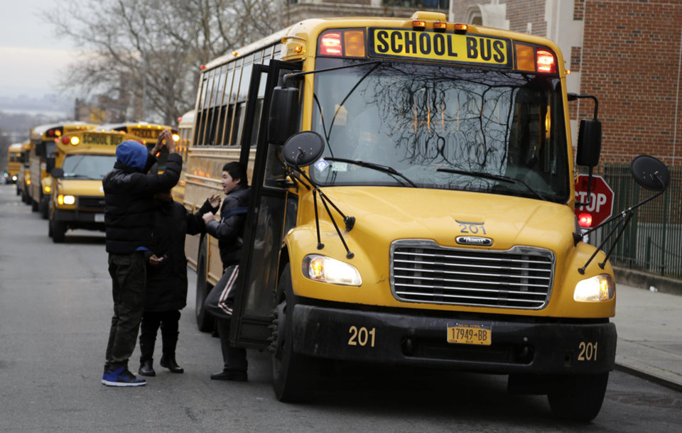 Photo - School buses line up to drop off students in New York, Tuesday, Jan. 15, 2013.  A strike by New York City school bus drivers that had been threatened for weeks will start Wednesday morning, affecting 152,000 students, the president of the union representing the drivers announced Monday. (AP Photo/Seth Wenig)