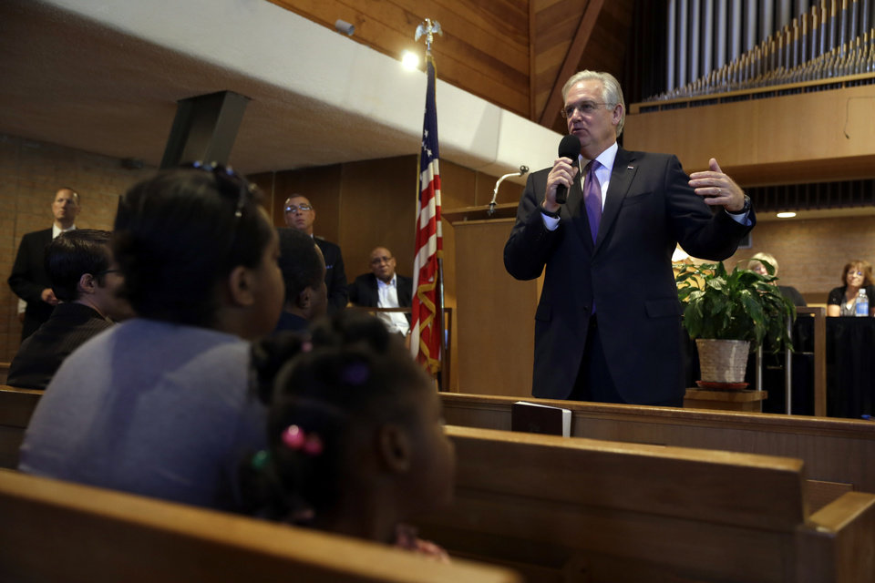 Photo - Missouri Gov. Jay Nixon speaks during a meeting of clergy and community members, Thursday, Aug. 14, 2014, in Florissant, Mo. Nixon says