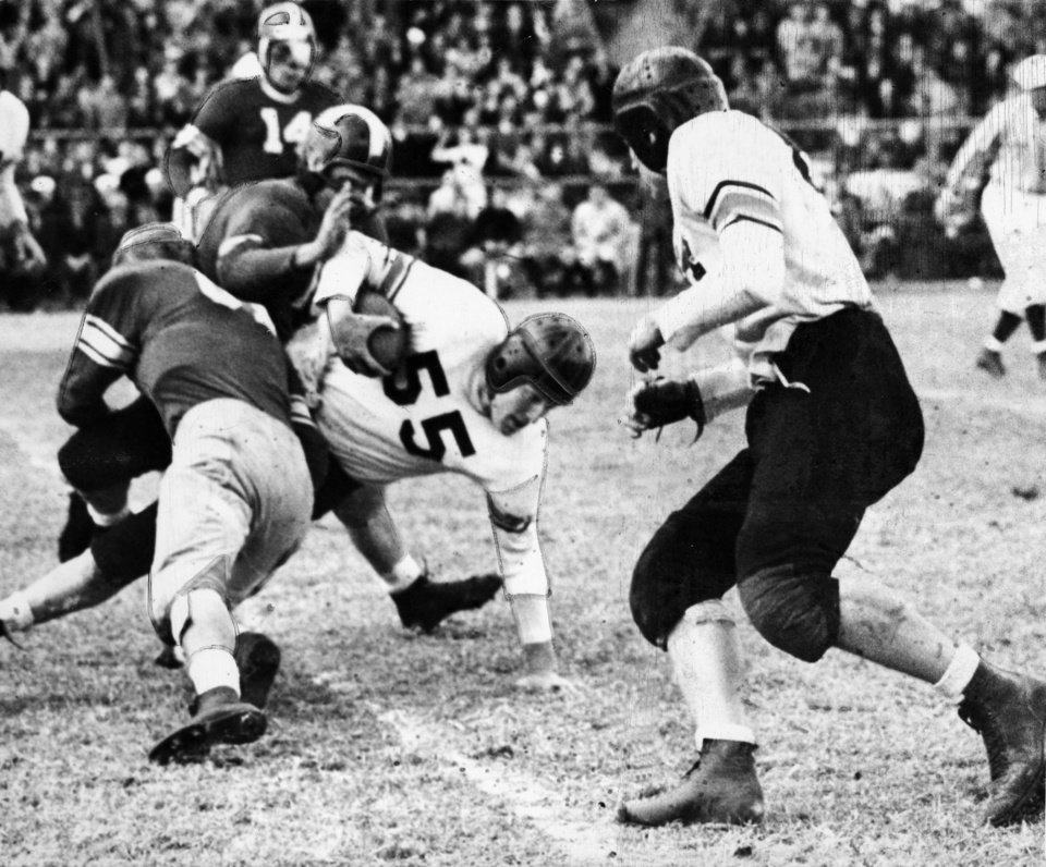 Photo - Oklahoma A&M University running back Bob Fenimore is stopped by OU's Homer Sparkman (back to camera) and Bob Mayfield during the Aggie's 28-6 victory over the University of Oklahoma Sooners at Taft Stadium. Staff photo taken Nov. 25, 1944.