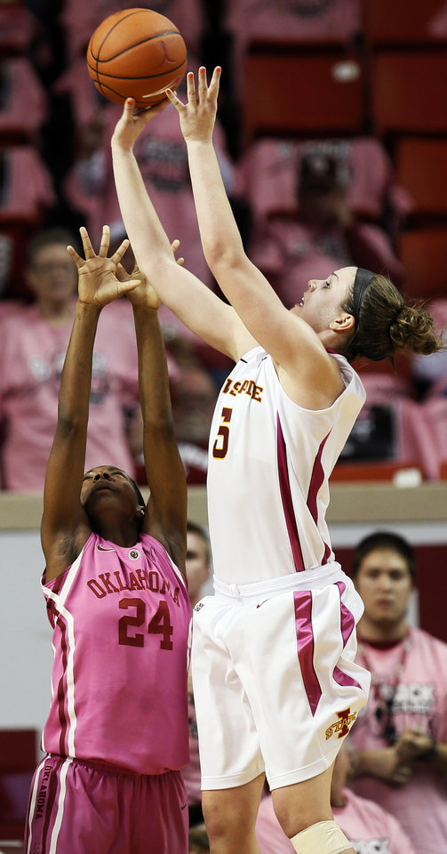 Photo - Iowa State's Hallie Christofferson (5) shoots over Oklahoma's Sharane Campbell (24) during an NCAA women's basketball game between the University of Oklahoma (OU) and Iowa State at the Lloyd Noble Center in Norman, Okla., Thursday, Feb. 14, 2013. Iowa State won, 72-68. Photo by Nate Billings, The Oklahoman