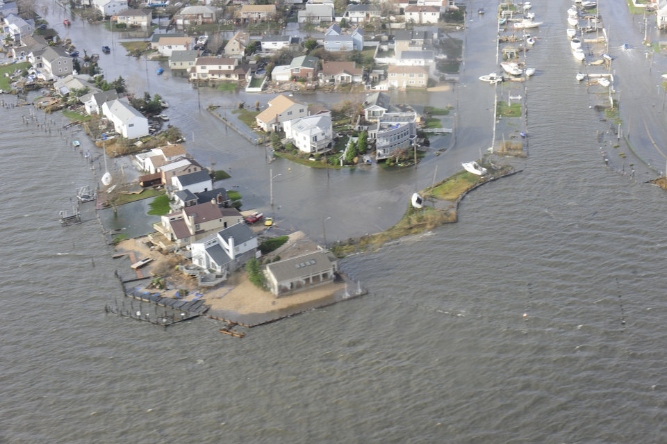 This image provided by the U.S. Coast Guard shows storm damage from Superstorm Sandy in a portion of New Haven Conn. taken during an overflight with Coast Guard Air Station Cape Cod, Mass, following Hurricane Sandy Wednesday Oct. 30, 2012. (AP Photo/US Coast Guard, Petty Officer 2nd Class Rob Simpson)