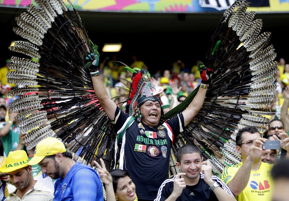 Photo - A Mexican fan shows off his costume before the group A World Cup soccer match between Brazil and Mexico at the Arena Castelao in Fortaleza, Brazil, Tuesday, June 17, 2014. (AP Photo/Andre Penner)