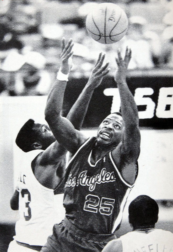 Former OU basketball player Wayman Tisdale. INDIANAPOLIS, Jan. 12 -- THE EYES HAVE IT -- Los Angeles Clippers forward Earl Cureton (25) blocks out Indiana Pacer Wayman Tisdale as they go up for a rebound in NBA action in Indianapolis Monday. The Pacers defeated the Clippers 111-90. (AP LaserPhoto) str-Tom Strattman 1988.  OPUBCO cutline - Los Angeles Clipper Earl Cureton (25) and Indiana Pacer Wayman Tisdale, left, struggle for the ball in Monday night's NBA game at Indianapolis. 1-13-88 ORG XMIT: KOD