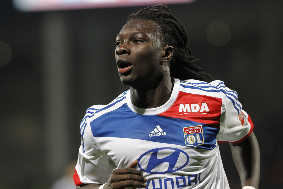 Photo - Lyon's Bafe Gomis celebrates after scoring against Montpellier during their French League One soccer match at Gerland stadium, in Lyon, central France, Saturday, Dec. 1, 2012. (AP Photo/Laurent Cipriani)