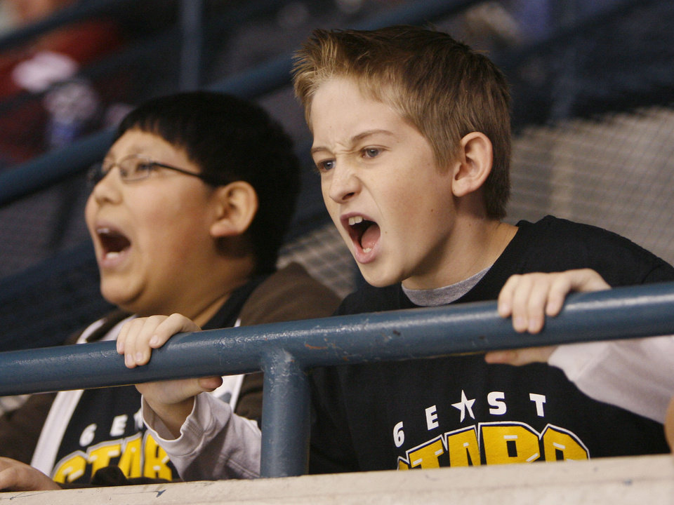 Photo - Mustang Middle School students Randy Vallejo, 11 (left), and Zack Croisant, 12, along with several thousand other schoolchildren from across the metro attend a hockey game as the OKC Blazers play against Texas at the Ford Center in Oklahoma City, OK, Tuesday, Feb. 10, 2009. BY PAUL HELLSTERN, THE OKLAHOMAN