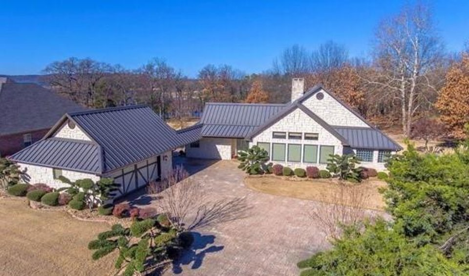 Photo -  This home, including guesthouse and two boatslips on 2.37 acres at Lake Eufaula's Spinnaker Point, is listed for $825,000 with Karen Weldin of Eufaula Lakeshore Realty, who is an agent for national brokerage Lake Homes Realty. [PHOTO PROVIDED BY LAKE HOMES REALTY]