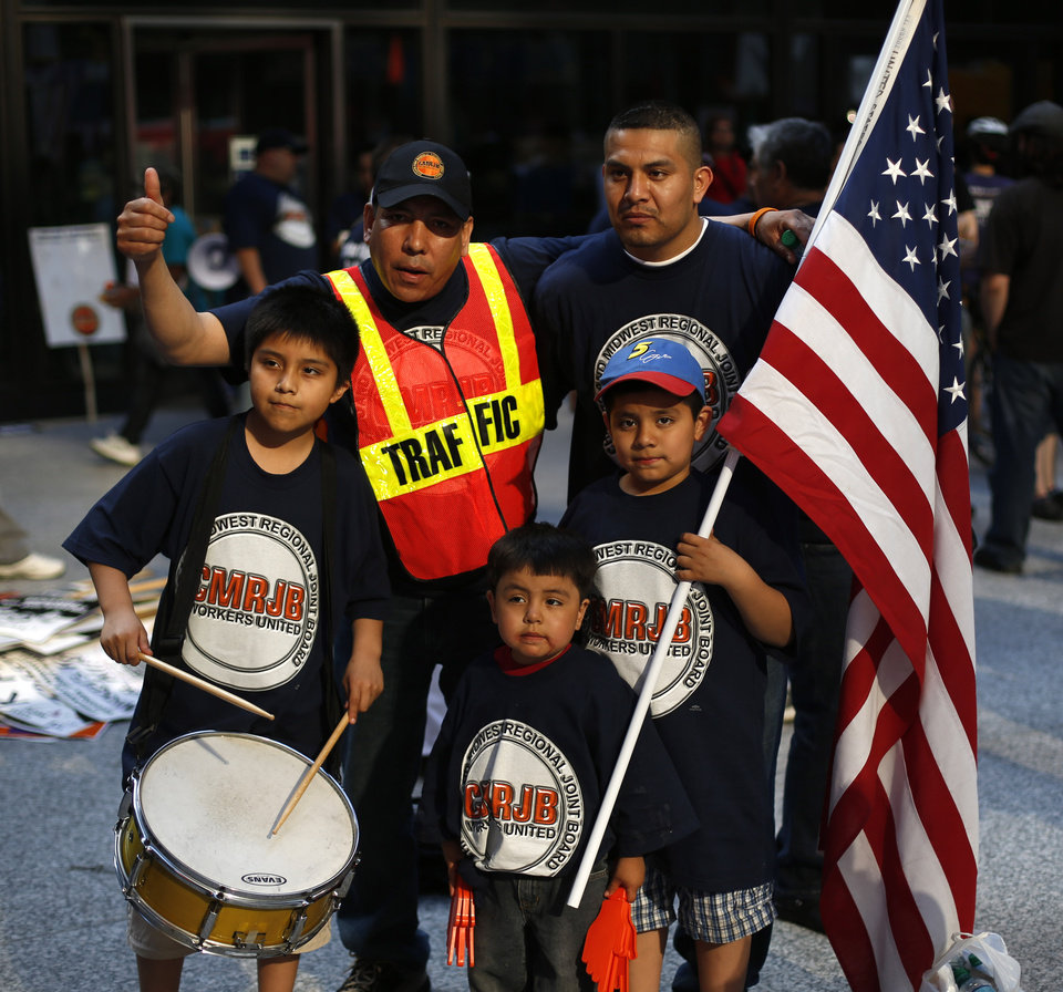 The Dominguez family join other immigrants and activists during a march and rally in Chicago calling for comprehensive immigration reform Wednesday, May 1, 2013. (AP Photo/Charles Rex Arbogast)