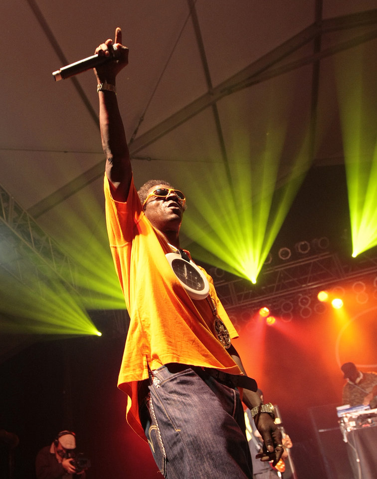 Photo -   FILE - In this June 12, 2009 file photo, Flavor Flav of Public Enemy performs during the Bonnaroo Arts and Music Festival in Manchester, Tenn. Public Enemy is nominated for induction into the Rock and Roll Hall of Fame in 2013. (AP Photo/Dave Martin, File)