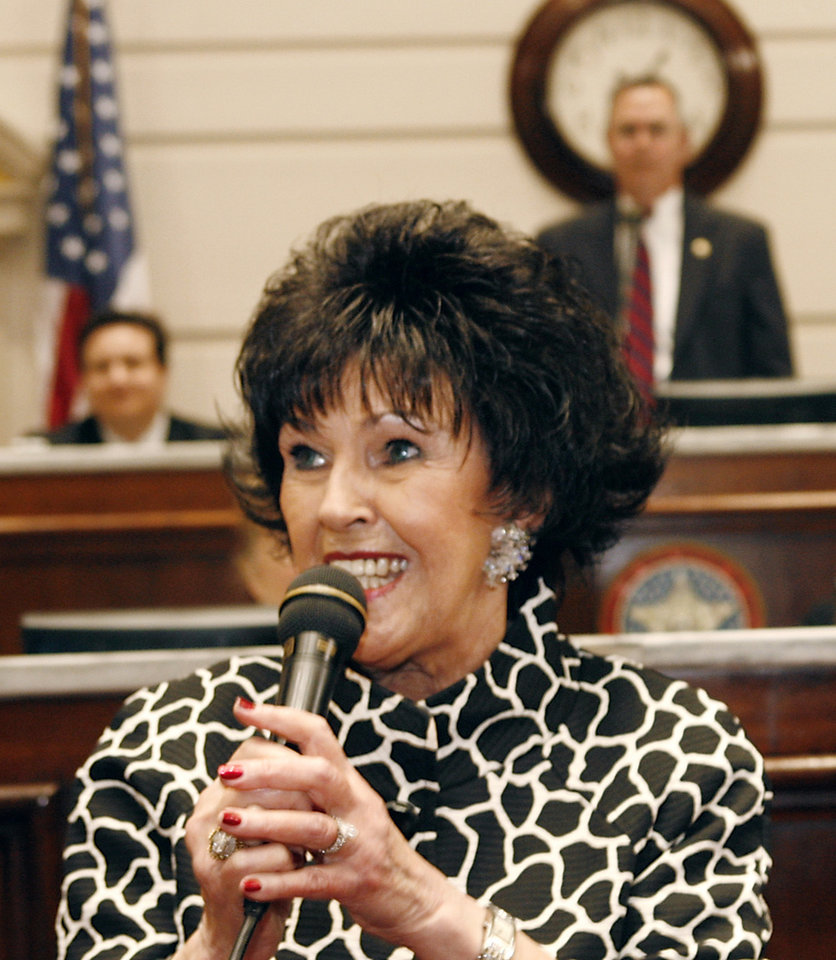 Photo - Singer and entertainer Wanda Jackson addresses lawmakers on the floor of the Senate at the state Capitol Tuesday afternoon, Feb. 10, 2009. Jackson was honored with a proclamation from Oklahoma Gov. Brad Henry for her lifetime's achievements in country and rockabilly music.   BY JIM BECKEL, THE OKLAHOMAN