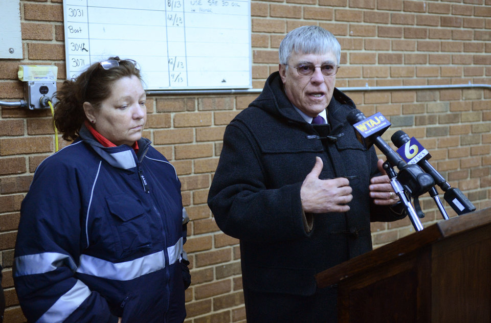 Photo - Blair County District Rich Consiglio, right, and Blair County Coroner Patricia Ross talk to the media about a shooting in rural central Pennsylvania on Friday, Dec. 21, 2012 in Geesytown, Pa. The suspect fired at troopers responding to Friday morning's shootings in Frankstown Township, about 70 miles west of Harrisburg. The fleeing gunman then crashed head-on into a trooper's car and got out of his truck and shot again at police, who returned fire and killed him. Consiglio says the gunman killed two men and one woman. (AP Photo/Altoona Mirror,  J.D. Cavrich)