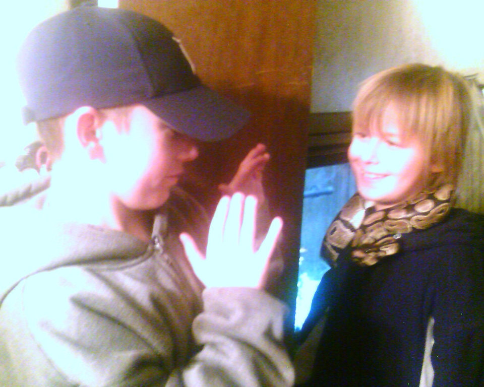 Kash's adopted brother introduced to kash's snake..... He didn't want no part of the thrill of that snake..<br/><b>Community Photo By:</b> Tama<br/><b>Submitted By:</b> Tama, Midwest
