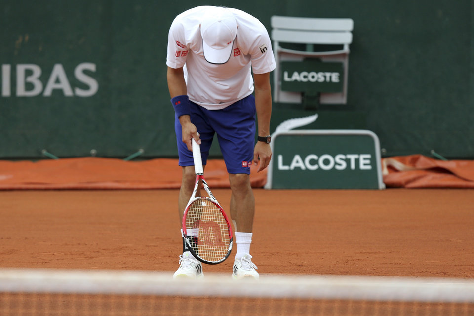 Photo - Japan's Kei Nishikori vents his frustration after missing a return during the first round match of the French Open tennis tournament against Slovakia's Martin Klizan at the Roland Garros stadium, in Paris, France, Monday, May 26, 2014. Nishikori lost in three sets 6-7, 1-6, 2-6. (AP Photo/David Vincent)