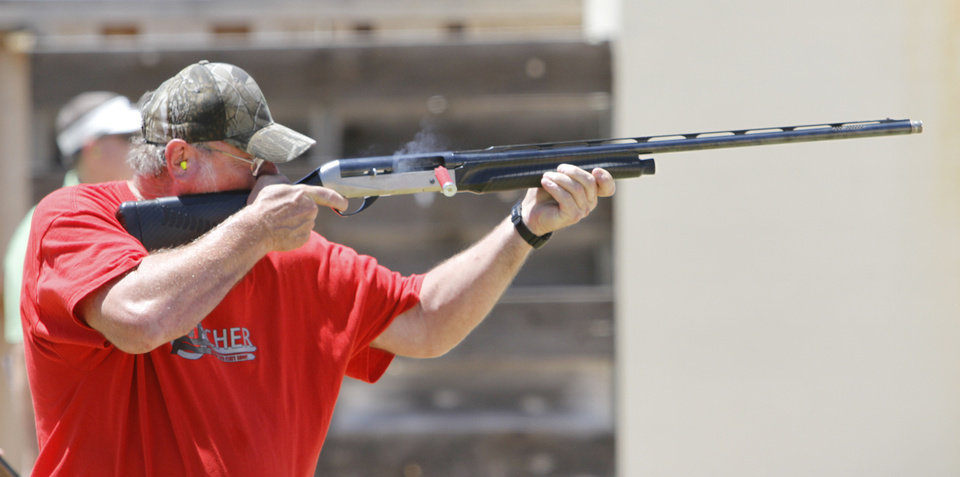 Photo - Bo Osborn with Carney, schools shoots trap during the Oklahoma Wildlife Department's Scholastic Shooting Program at the OKC Gun Club in Oklahoma City, Thursday June 11, 2013. Photo By Steve Gooch, The Oklahoman