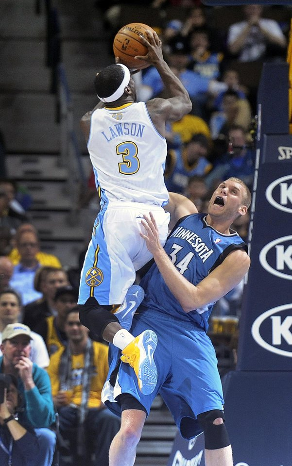 Denver Nuggets guard Ty Lawson, left, collides with Minnesota Timberwolves center Greg Stiemsma, right, in the first quarter of an NBA basketball game on Saturday, March 9, 2013, in Denver.  (AP Photo/Chris Schneider)