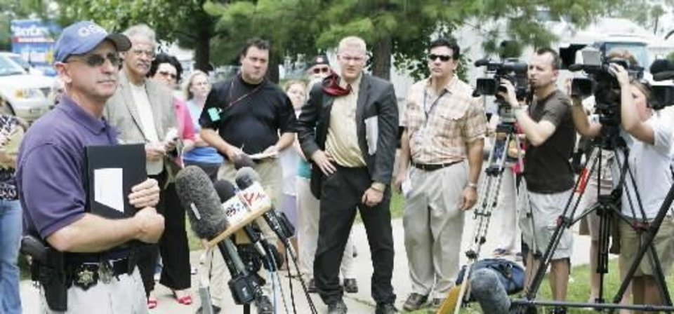 Photo - OSBI Agent Ben Rosser speaks at a press conference at the Okfuskee County Courthouse, Thursday, June 12, 2008. Photo by David McDaniel