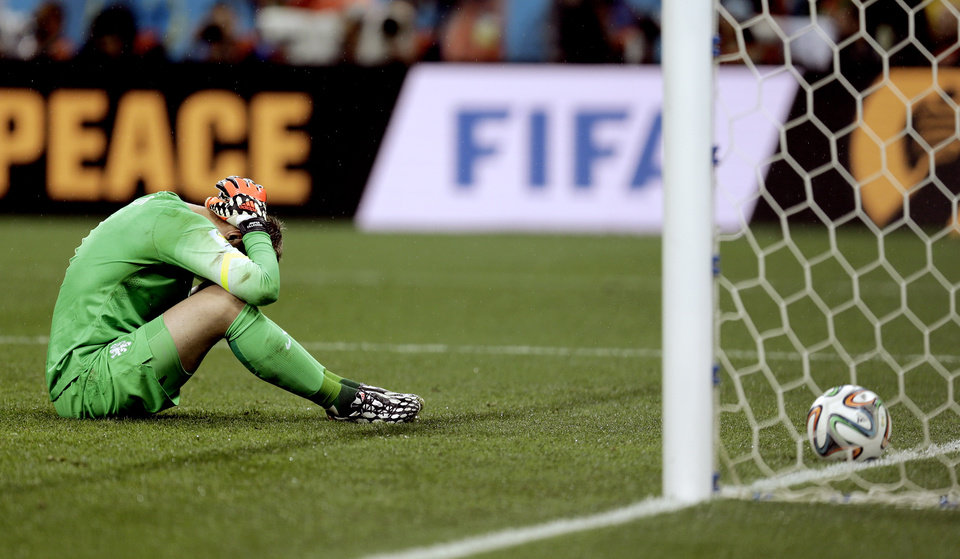 Photo - Netherlands' goalkeeper Jasper Cillessen reacts after being scored on by Argentina's Maxi Rodriguez during a penalty shootout after extra time during the World Cup semifinal soccer match between the Netherlands and Argentina at the Itaquerao Stadium in Sao Paulo Brazil, Wednesday, July 9, 2014. Argentina defeated the Netherlands 4-2 in a penalty shootout after a 0-0 tie to advance to the finals. (AP Photo/Natacha Pisarenko)