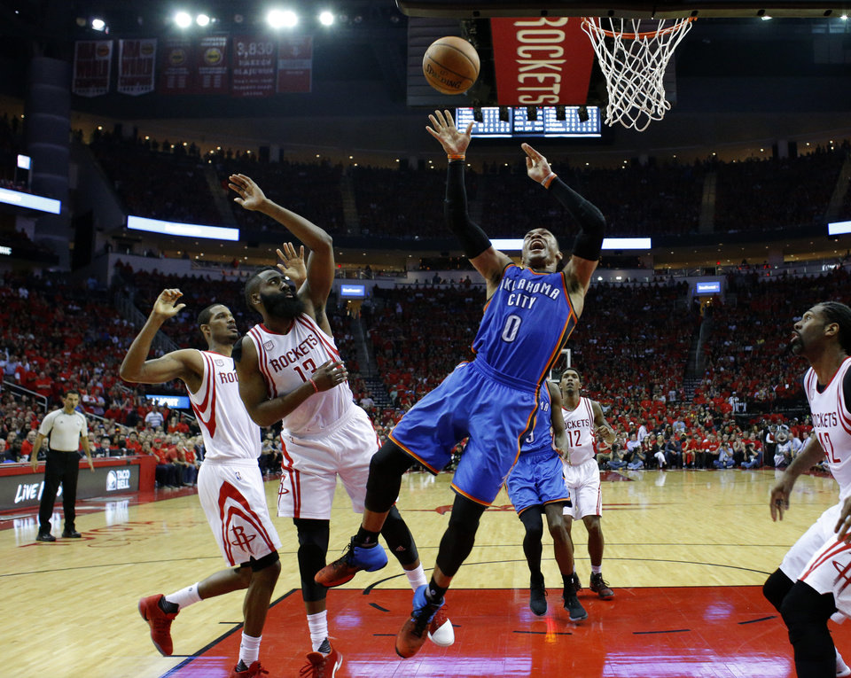 Photo - Houston's James Harden (13) defends against Oklahoma City's Russell Westbrook (0) as he goes to the basket during Game 5 in the first round of the NBA playoffs between the Oklahoma City Thunder and the Houston Rockets in Houston, Texas,  Tuesday, April 25, 2017.  Houston won 105-99. Photo by Sarah Phipps, The Oklahoman