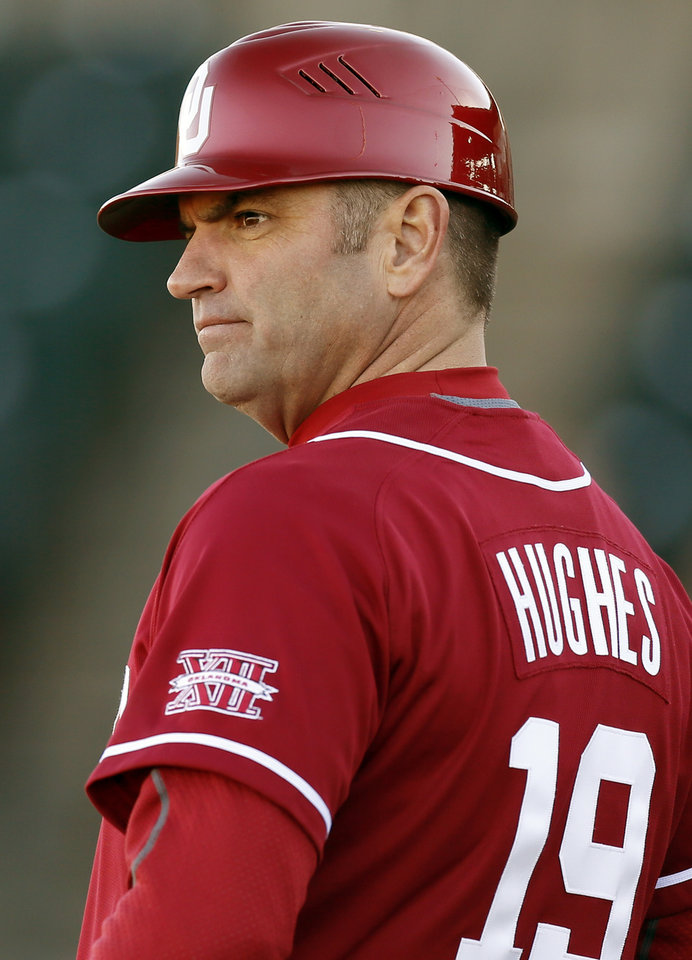 Photo - Oklahoma head coach Pete Hughes (19) coaches third base during OU's season-opening college baseball game against Seton Hall at L. Dale Mitchell Park in Norman,  Okla., Friday, Feb. 14, 2014. Photo by Nate Billings, The Oklahoman