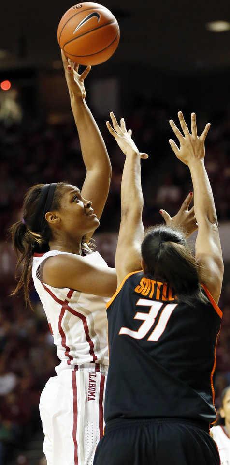 Photo - Oklahoma's Kaylon Williams (42) shoots over Oklahoma State's Kendra Suttles (31) in the second half during a women's Bedlam college basketball game between the Oklahoma State University Cowgirls (OSU) and the University of Oklahoma Sooners (OU) at Lloyd Noble Center in Norman, Okla., Saturday, Feb. 1, 2014. OU won, 81-74. Photo by Nate Billings, The Oklahoman